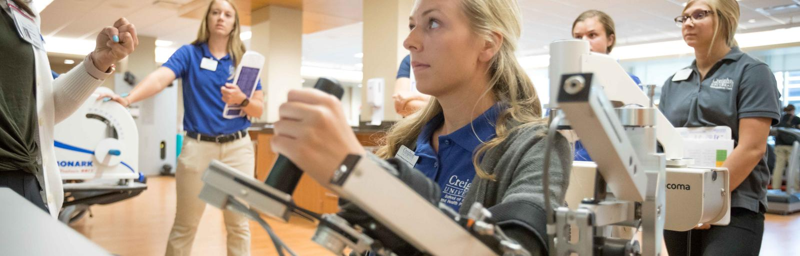 students using equipment with Creighton University's Occupational Therapy program