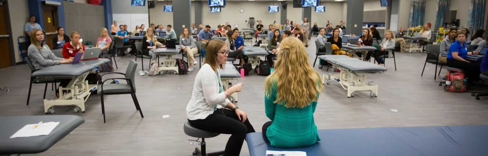 Creighton University School of Physical Therapy students listening to instructor.